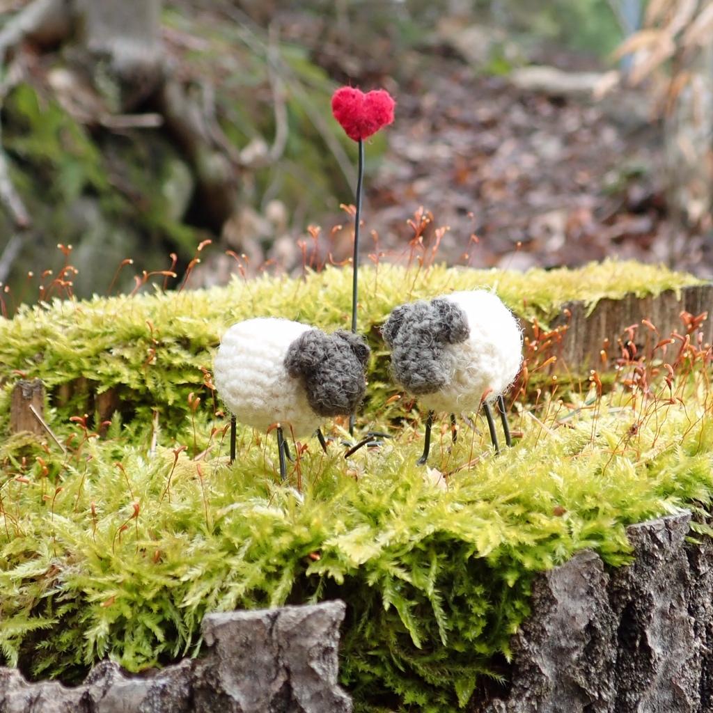 crochet sheep on mossy log
